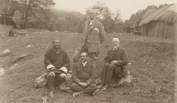 [Portrait group] Names: Standing - Mr Claude White. Sitting (from left) - Sir Ugyen Wang Chuk, Major Rennick, Mr Paul [Bhutan]
